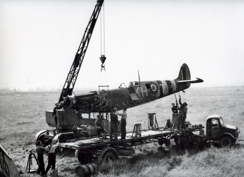 This is a wartime taken photo of RCAF techs recovering a crashed Spitfire